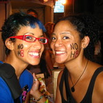 Nikhi - Before there were NOH8 tattoos, my sis and I showed our pride with black eyeliner and red lipstick.  This was at Gay Pride 2009!