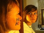 Haley Drozdowicz - This was taken after the NO H8 photoshoot in Milwaukee, Wisconsin.  The desperation for LGBTAQIQ equality is reflected in the mirror's glare. <3