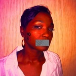 Joezette Julien - Behind this tape lies lips of a Salior who has administered basic life support without predjuice.