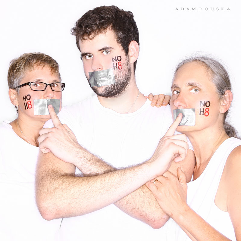Zach Wahls and Moms pose for NoH8